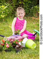 Little girl planting flowers
