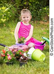 Little girl planting flowers