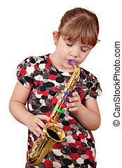 little girl play music on saxophone