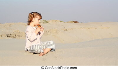 little girl play pan-pipe