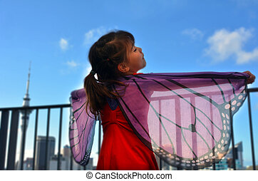 Little girl play pretend to be a butterfly