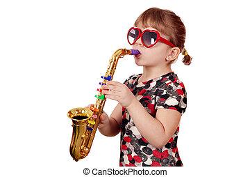 little girl play saxophone on white