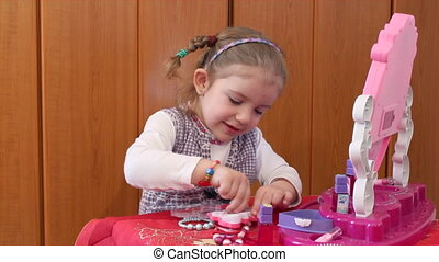 little girl play with make up
