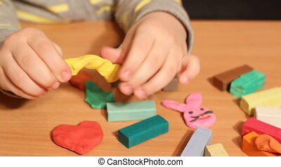 little girl play with plasticine
