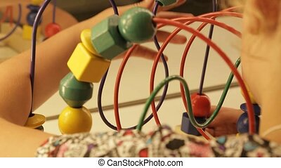 Little girl play with push bead