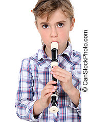 Little girl playing a recorder