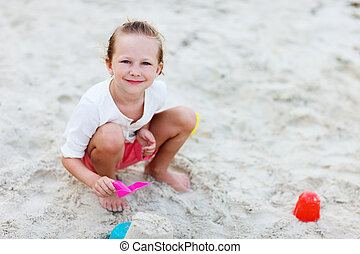 Little girl playing at beach
