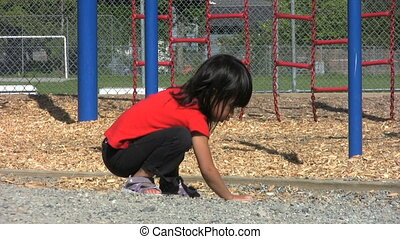 Little Girl Playing At Playground