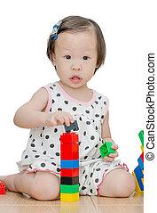 Little girl playing blocks