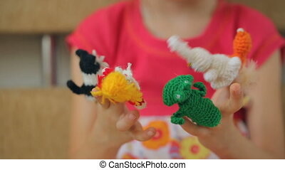 Little girl playing finger puppets