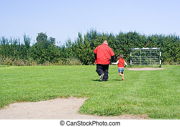 little girl playing footb