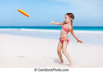 Little girl playing frisbee