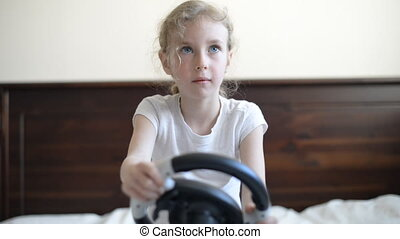 Little girl playing game. - Little girl playing game with...