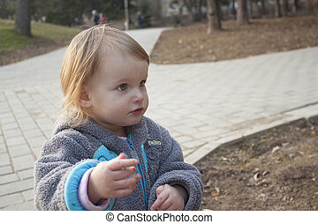 Little girl playing in a park