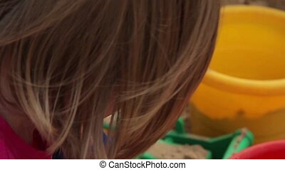 Little Girl Playing In A Sandbox (P