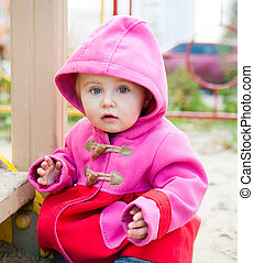 little girl playing in autumn