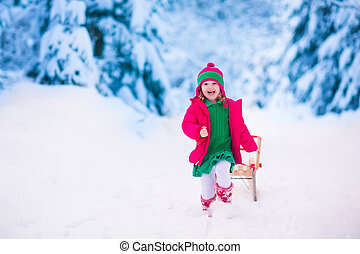 Little girl playing in snowy winter forest - Little girl ...