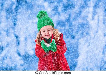 Little girl playing in snowy winter park - Little girl in ...