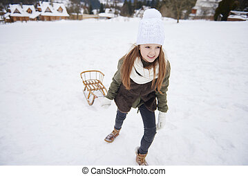Little girl playing in snowy winter place