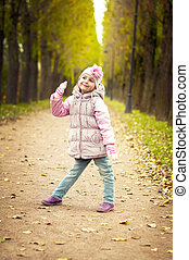 little girl playing in the park