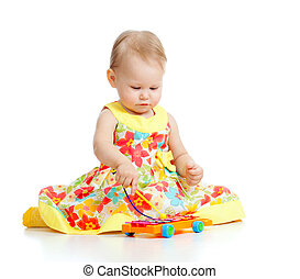 little girl playing musical toy