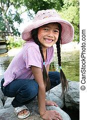 Little girl playing on rocks