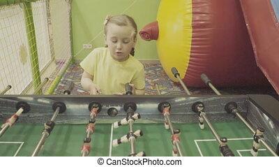 girl playing table football