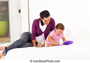 little girl playing toy laptop