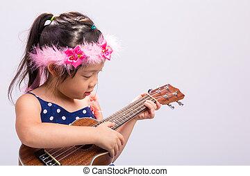 Little Girl Playing Ukulele / Little Girl Playing Ukulele Background