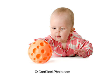Little girl playing with a ball