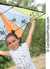 Little girl playing with a kite