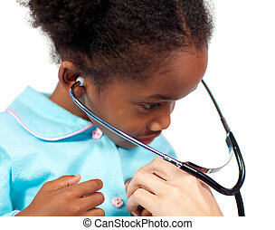 Little girl playing with a stethoscope at a medical check-up
