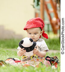 little girl playing with a toy bear