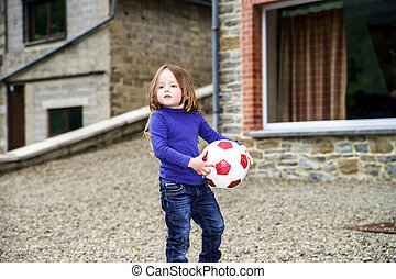 Little girl playing with ball