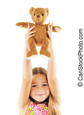 Little girl playing with bear toy