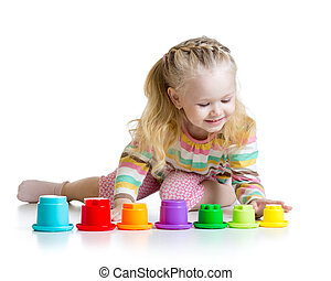 little girl playing with color toys
