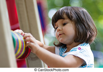 Little girl playing with counting circles