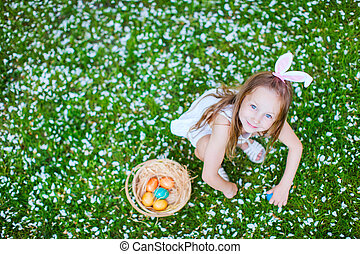 Little girl playing with Easter eggs - Above view of...