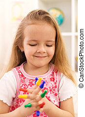 Little girl playing with game pieces