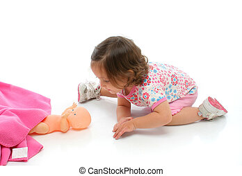 Little girl playing with her baby