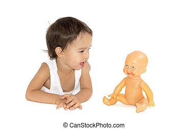little girl playing with her doll in studio