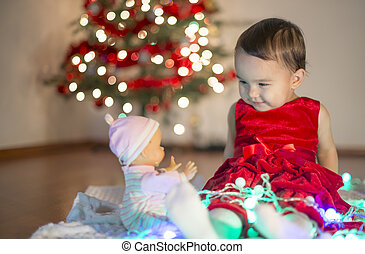 Little girl playing with her first xmas gift