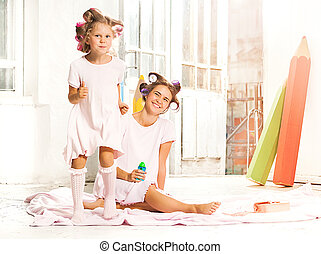 Little girl playing with her mother