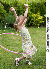 Little girl playing with hula hoop - Smiling little girl...