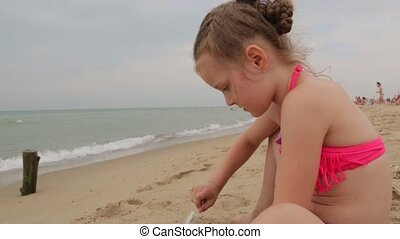 Little Girl Playing With Sea Sand