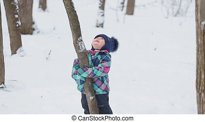 Little girl playing with snow