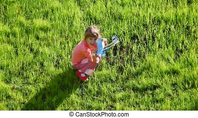 little girl playing with toy aircraft