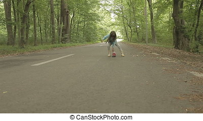 Little Girl Playing with Toy Fire Engine on Road in Forest -...