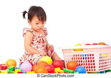 Little girl playing with toy