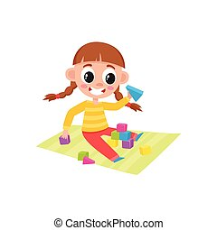 Little girl playing with toy wooden blocks